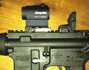 Note the optics co-witness height with back up iron sights