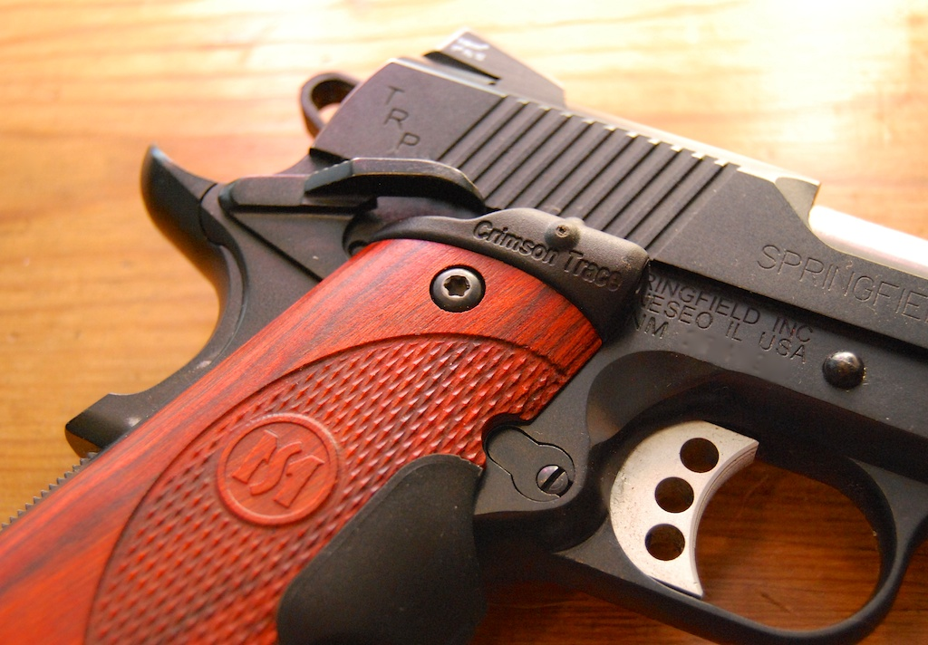 Does anything complement a sweet 1911 like wood grips? Better yet, wood Lasergrips?