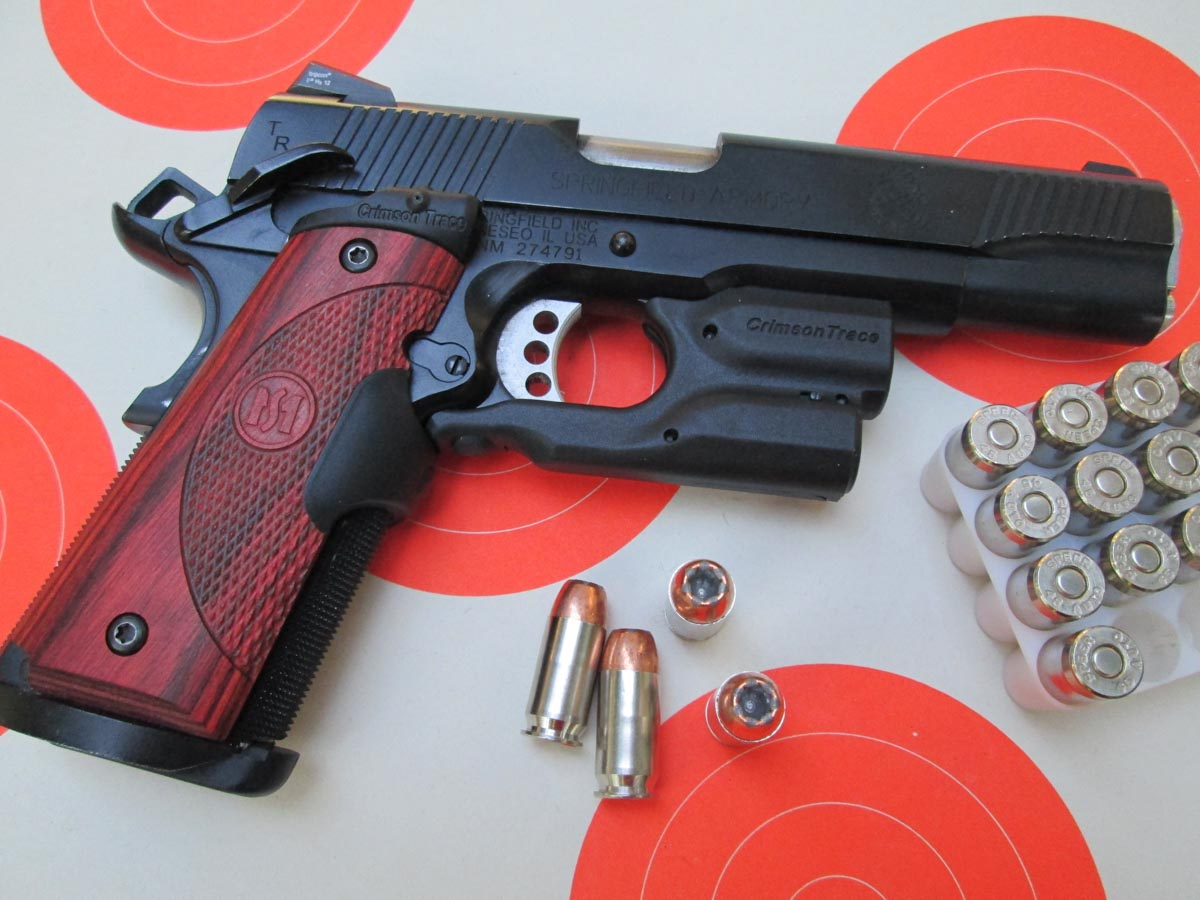 This Springfield Armory 1911 TRP has Crimson Trace Lasergrips and a Crimson Trace Lightguard. Neither one makes this gun any more difficult to carry.